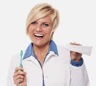 Lady with toothbrush and toothpaste