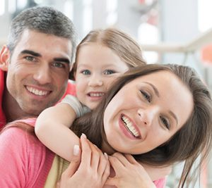Ask your dental team - shows parents with daughter