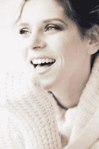 Women in white jumper smiling
