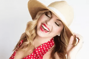 Women in hat with red lips and a smile