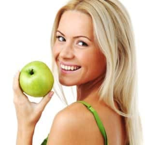 SpaDental Essentials lady with apple
