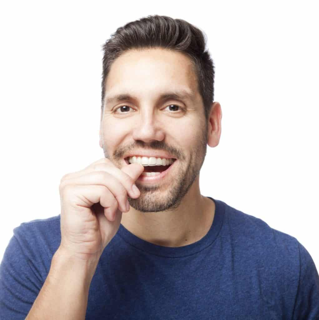 Invisalign clear braces Man checking his clear braces