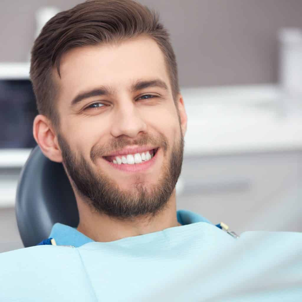 restorative care shows man in dentists chair having treatment