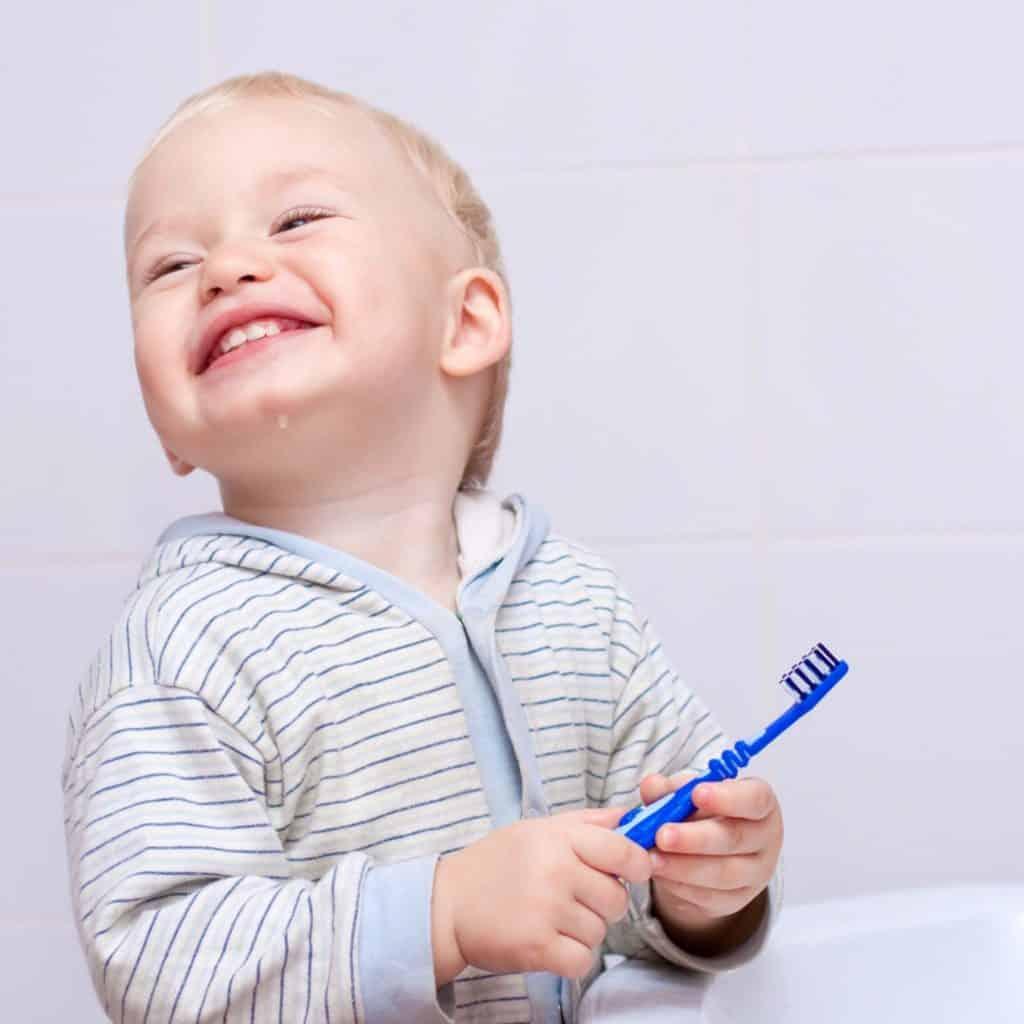 baby cleans teeth