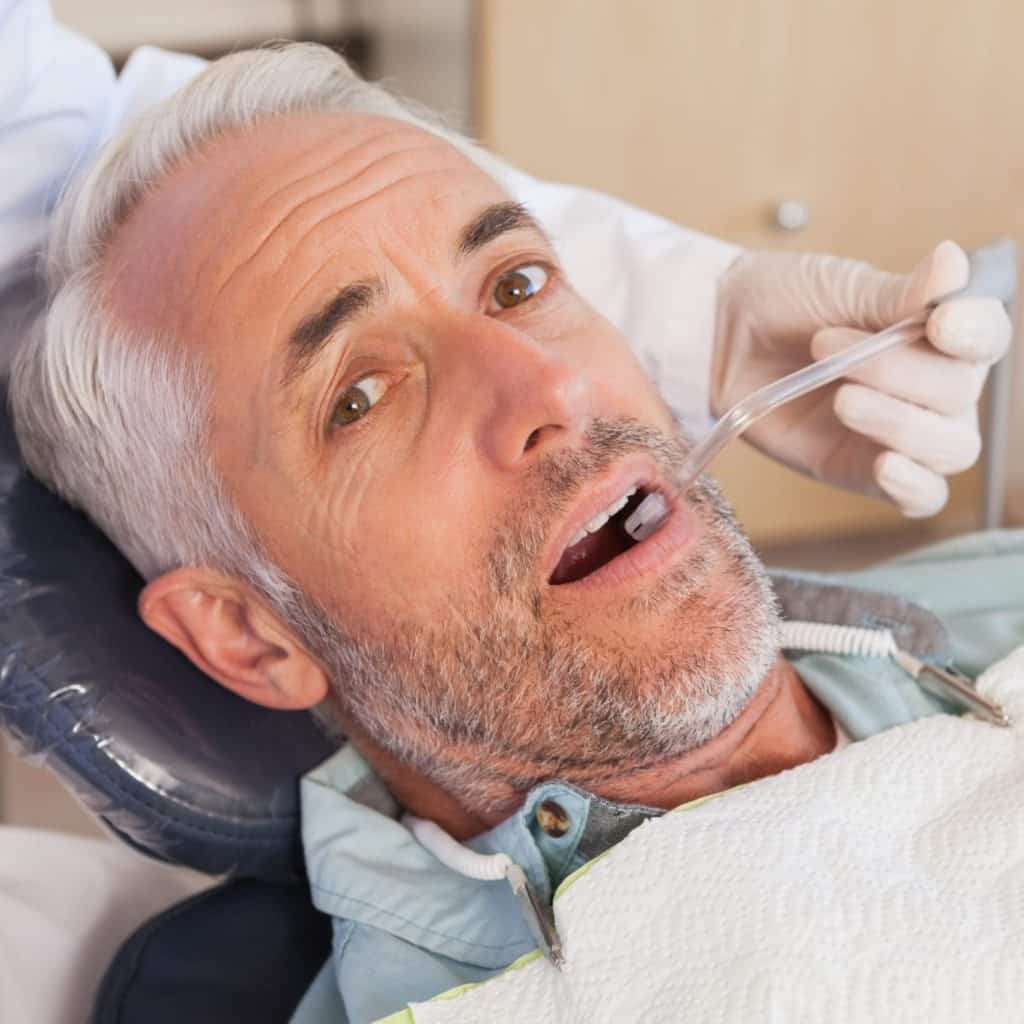 nervous patient, male, in the dentist's chair
