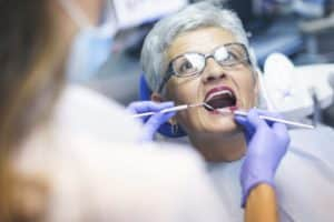 direct access to your dental therapist - patient in dental office having a dental check.
