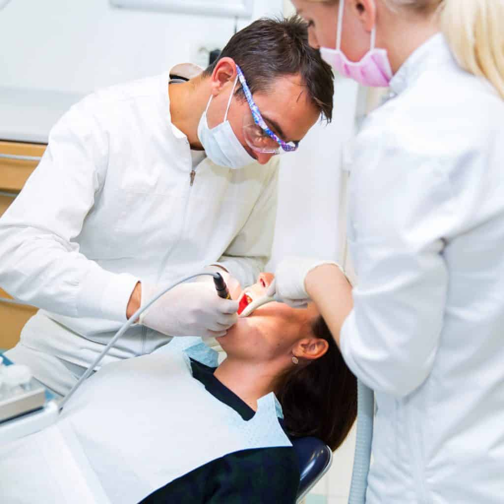Two dentists doing oral surgery