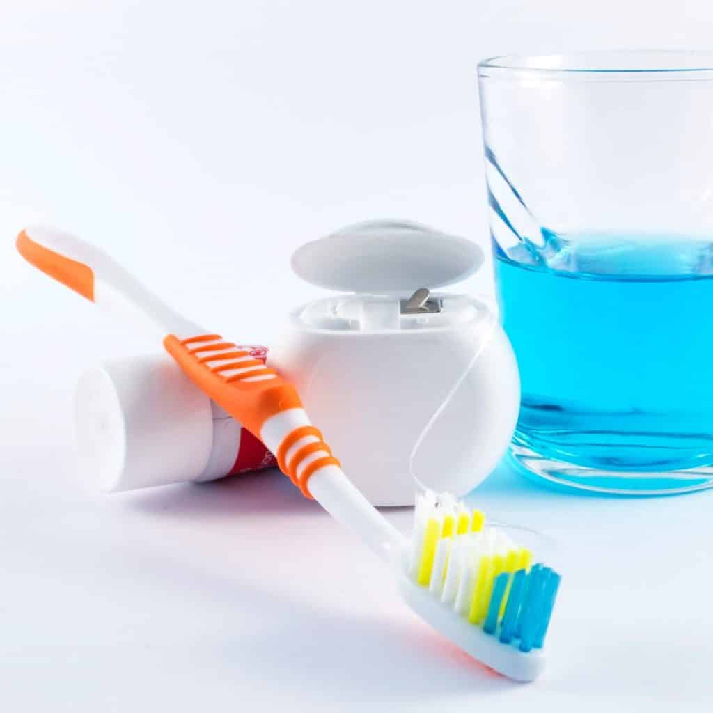 Toothbrush, dental floss, toothpaste and mouthwash