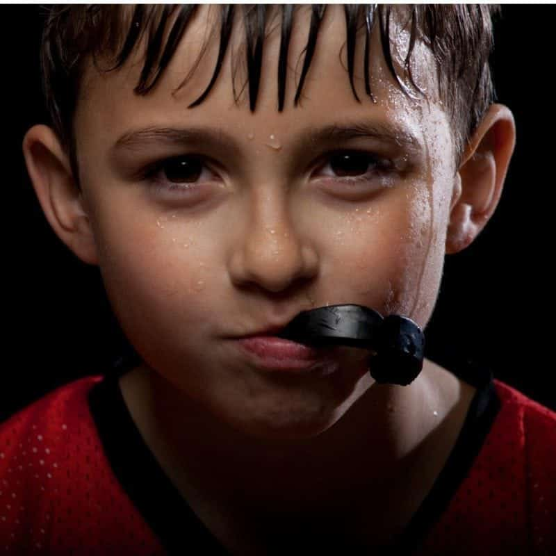 Young athlete with mouth guard