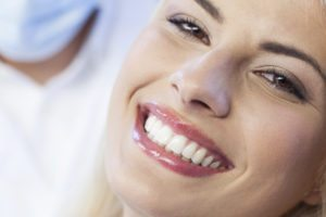 brilliant tooth whitening - close up of woman with white teeth