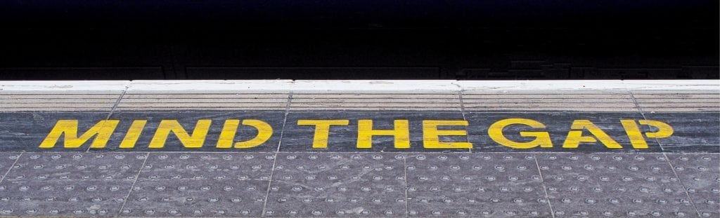 text reads mind the gap on a platform as missing teeth matter