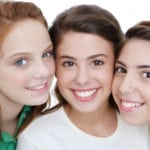 back to school tooth care answers for three teenage girls shown smiling