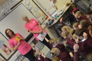 Better brushing taught by two women in pink uniform