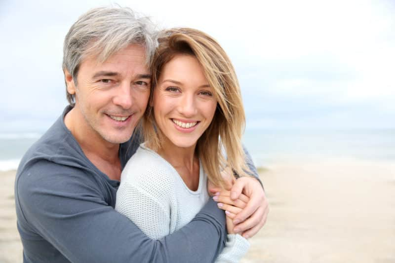 dental implant steps for an older couple oh holiday enjoying life