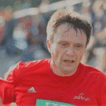 a man in a red shirt running as its good for teeth