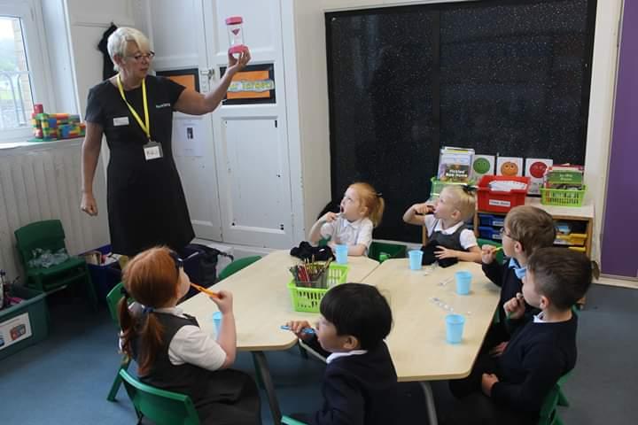 Lorraine Allen with children in Plymouth community ourteach project