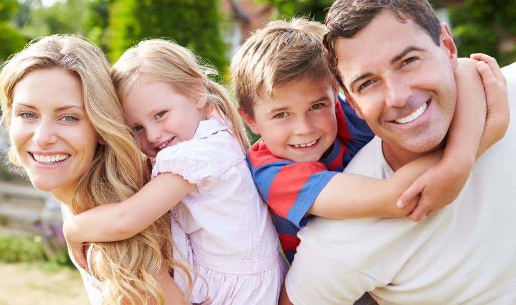 A plymouth dentists excellent care shows happy family of four_156648317