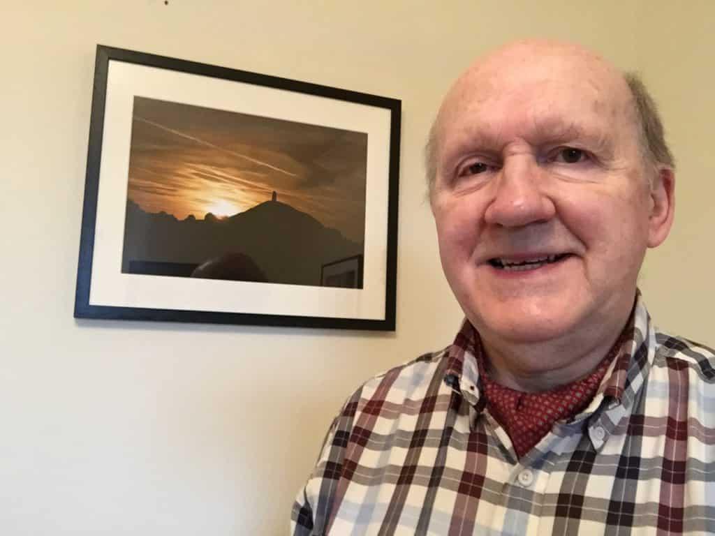 portrait of Peter Longden at photography exhibition