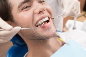 dental checks for twenties teeth man in dental chair