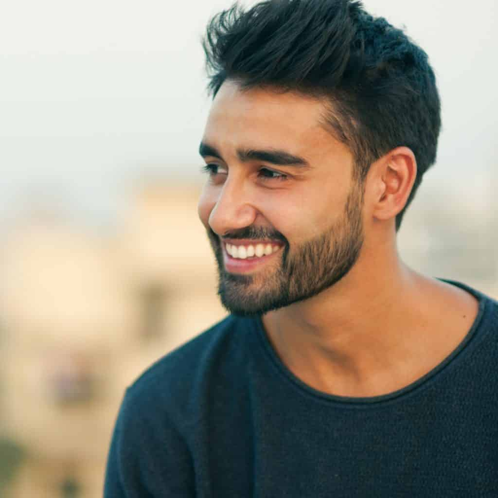 Ramadan oral health portrait of bearded man smiling