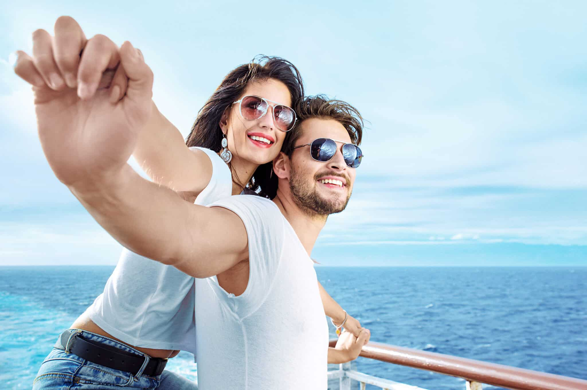 relaxed couple at front of boat independent dental care smiles