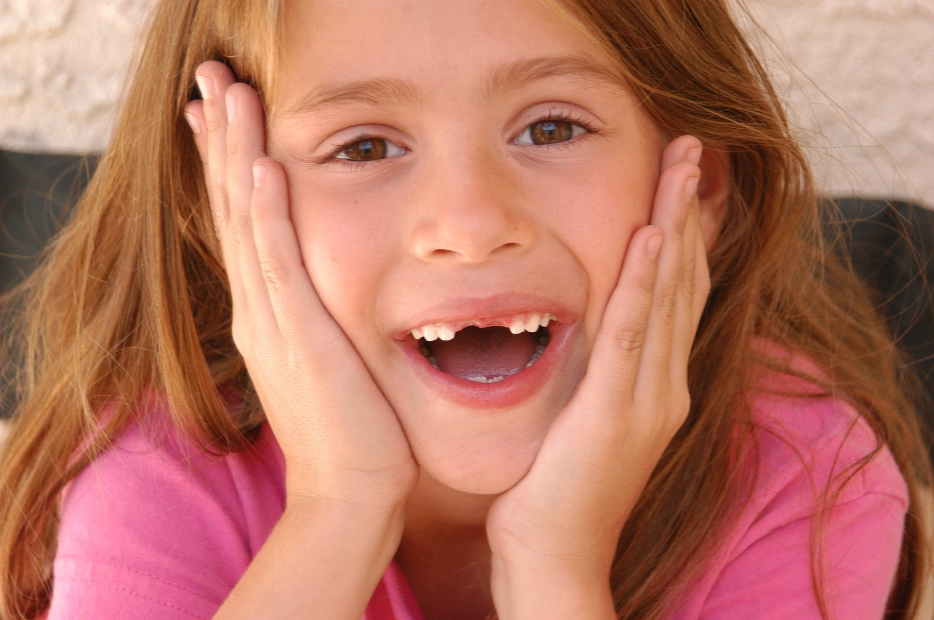 girl with two front teeth missing wearing pink shirt - poetry