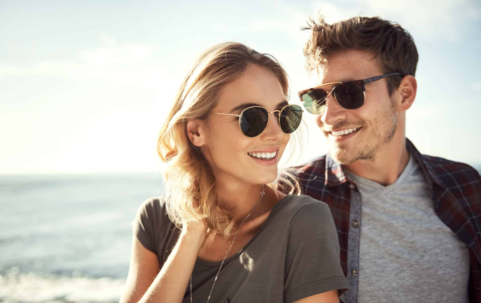 sunny smiles with vitamin D young couple in the sun wearing sunglasses